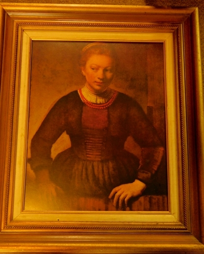 "FRAMED PRINT ""Young Woman At An Open Half Door"" by Rembrandt"