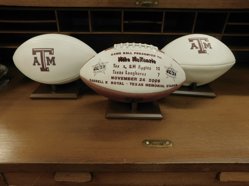 A&M FOOTBALLS~CENTER  BALL PRESENTED TO MIKE McKENZIE AFTER THE A&M-12 to TEX-7 GAME