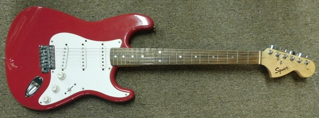 SQUIER STRAT BY FENDER ELECTRIC GUITAR, S/N CY0121126, VELVET LINED HARD CASE BY IBANEZ