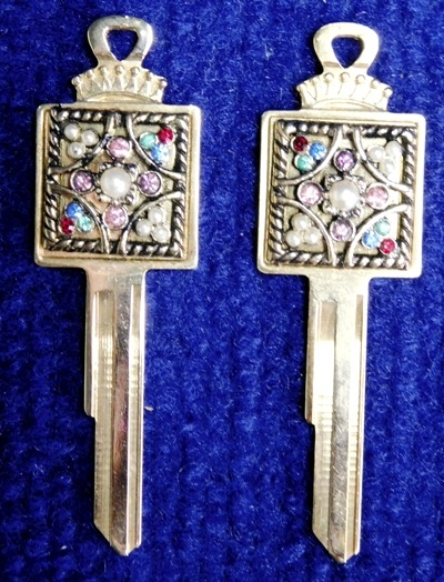 PAIR VINTAGE CADILLAC CAR KEYS