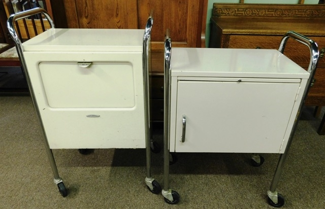 TWO SMALL MEDICAL METAL CABINETS ON ROLLERS