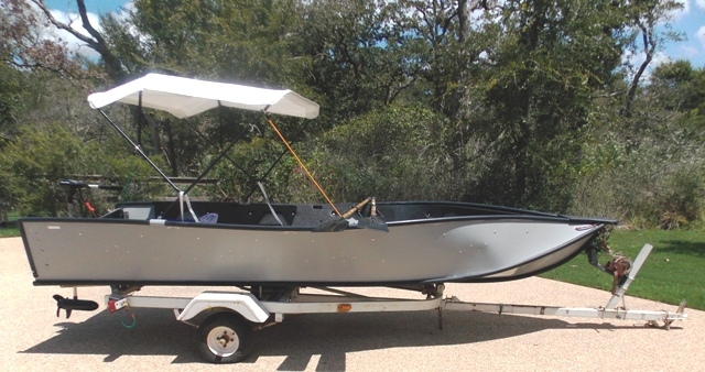 PORTA-BOTE 14' WITH TROWLING MOTOR & TRAILER