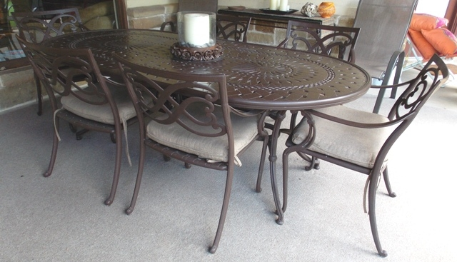 OVAL METAL PATIO TABLE & 8 ARM CHAIRS