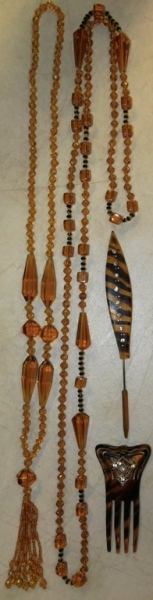 TWO AMBER GLASS FLAPPER BEADS; HAIR COMB & HAT PIN